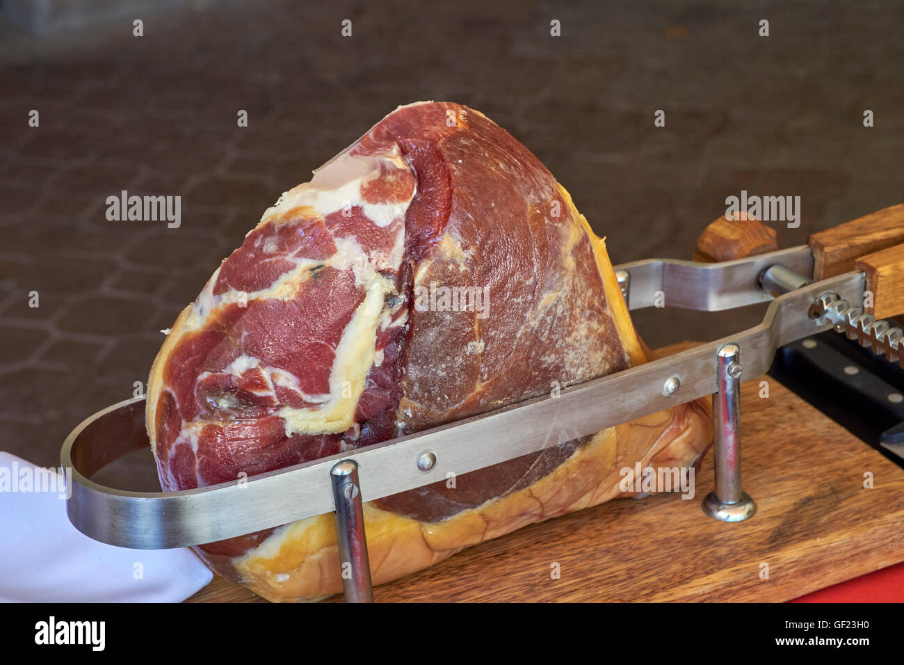 Jambon de Savoie clamped in a vice for carving.  Savoie, France. - Stock Image
