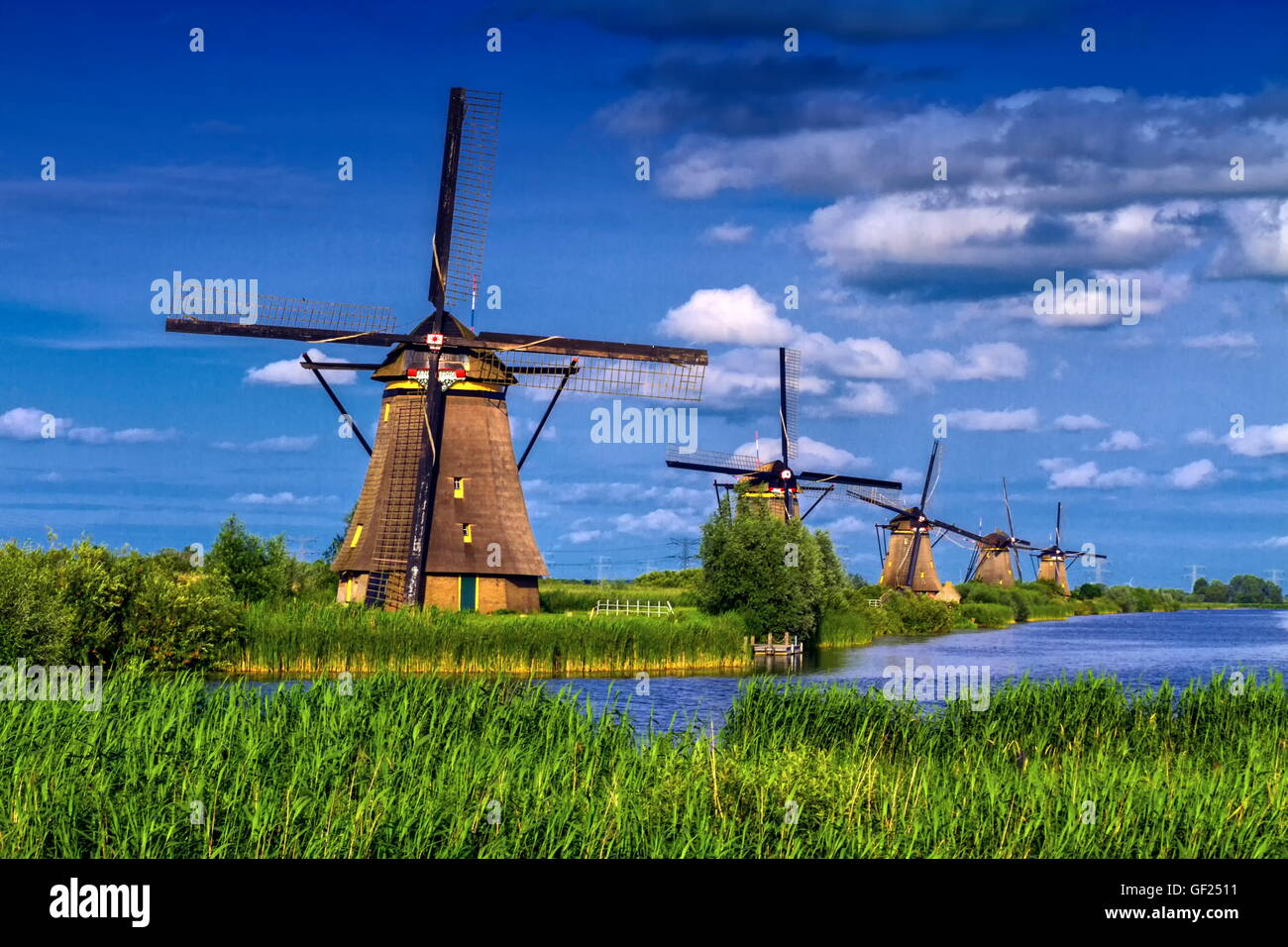 Famous historical windmills in Kinderdijk, Holland, Netherlands - Stock Image