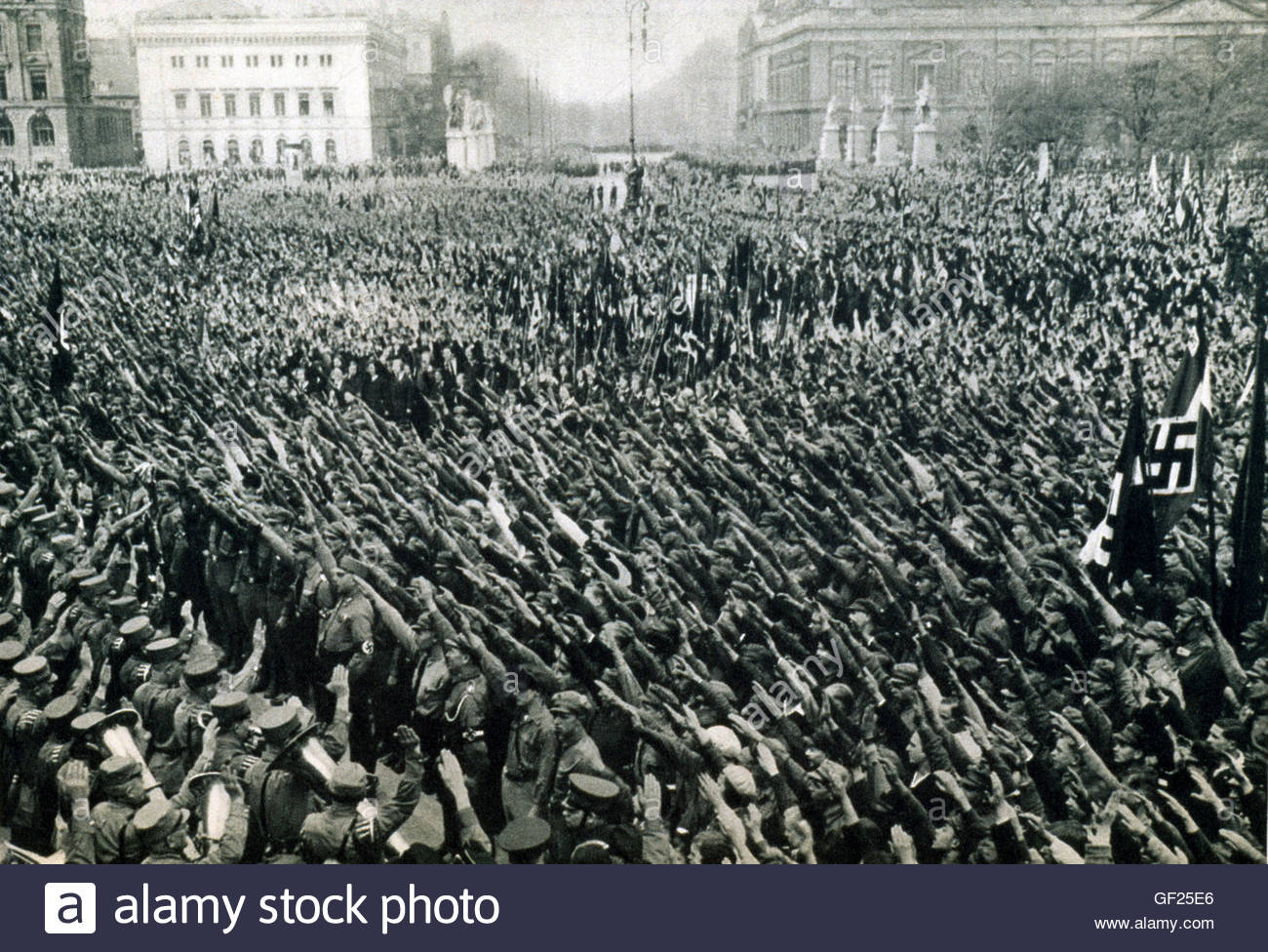Massive Rally Of The Hitler Youth Raise Their Arms In The Nazi Salute From The Hitler Book - Stock Image