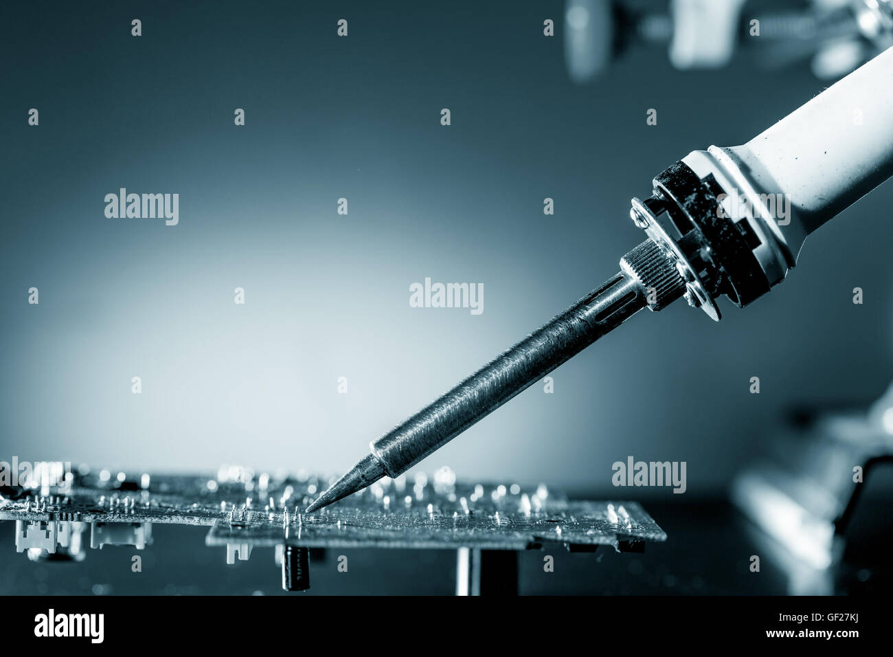 Use a soldering iron at fix - Stock Image