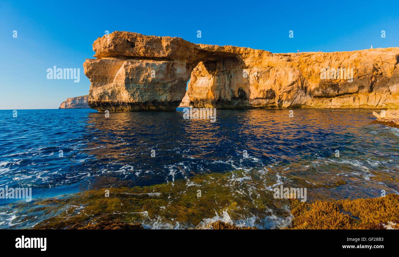 Azure Window, famous stone arch on Gozo island with reflection, Malta Stock Photo