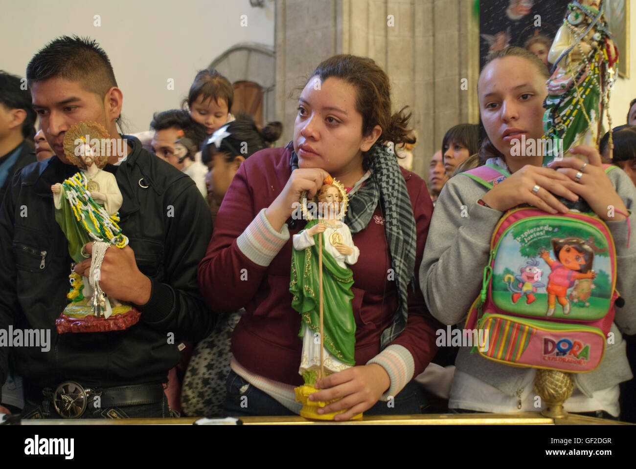 Worshipers with statues and other articles of devotion to Saint Jude Thaddeus, assist at a Mass on the saint's - Stock Image