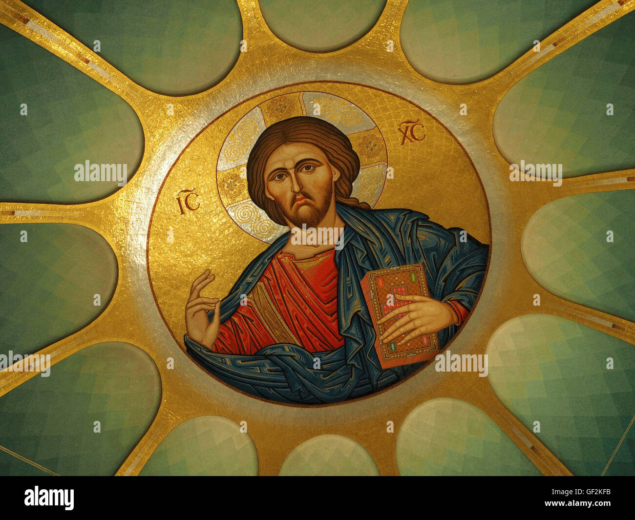 fabulous rich iconic imagery of Christ within dome of Orthodox church in the Albanian capital Tirana in the Balkans - Stock Image