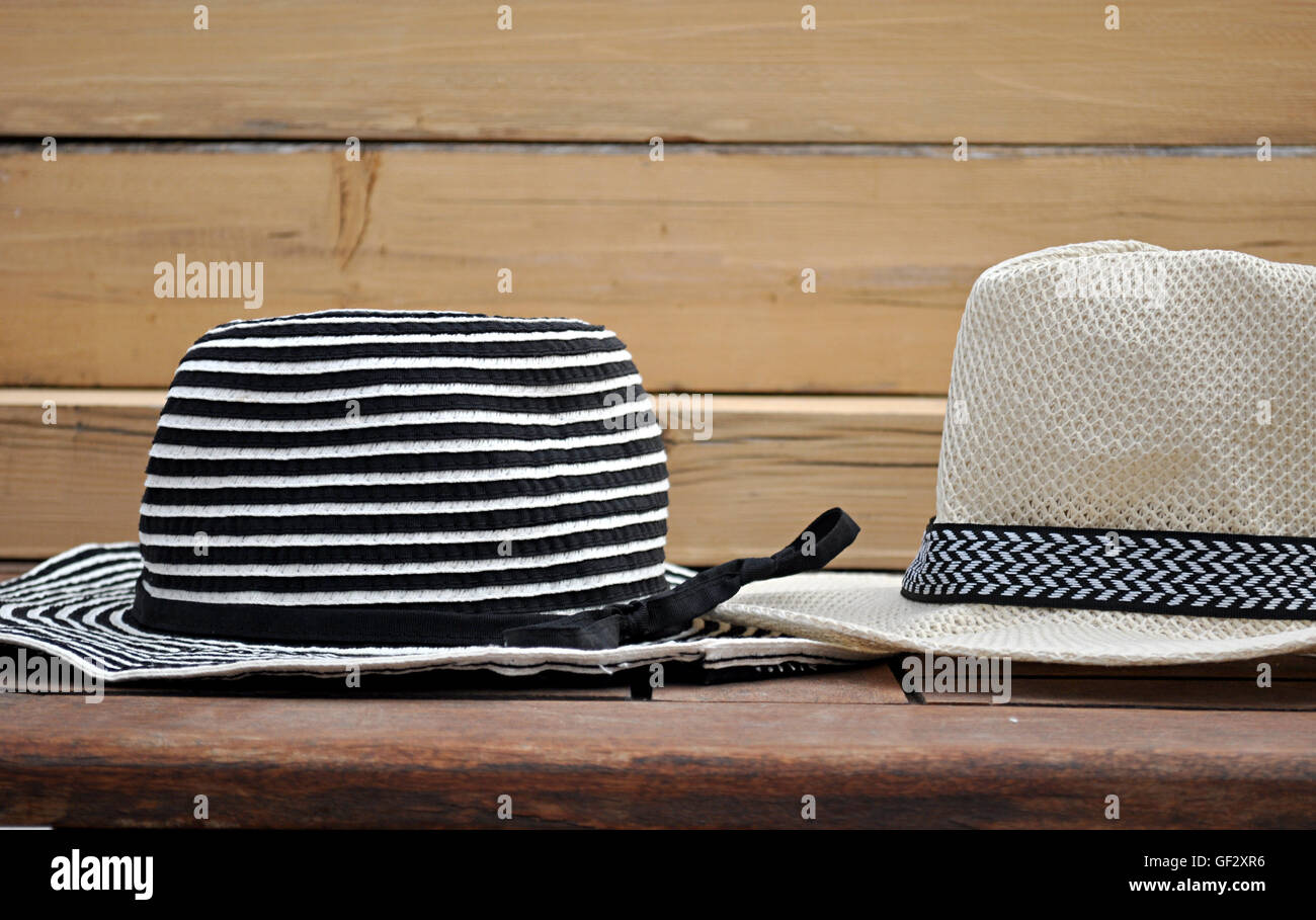 hats white, black and beige - Stock Image