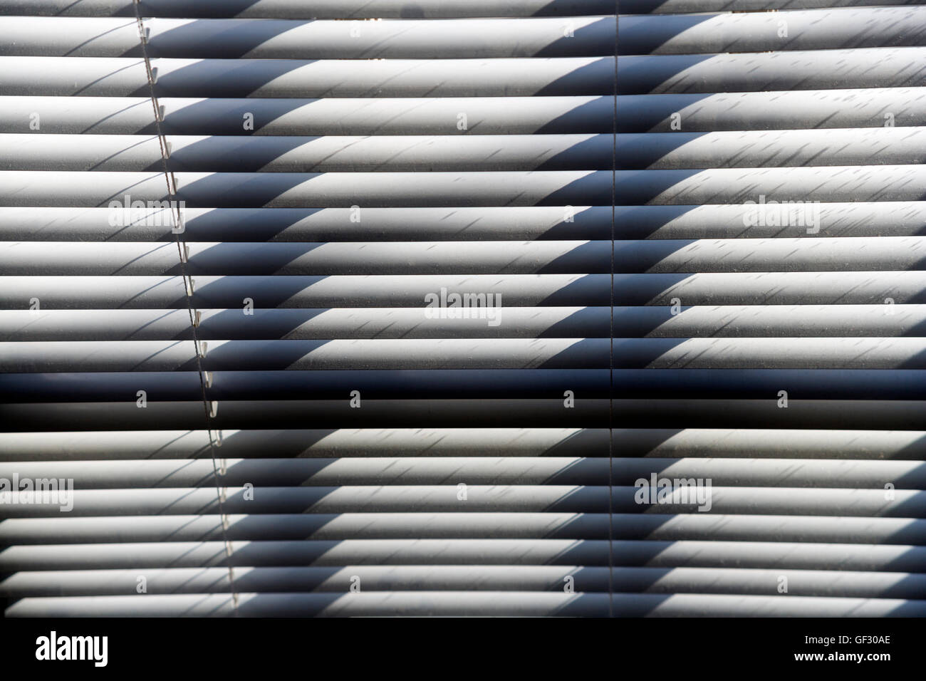 Abstract photo of sunlight on venetian blinds - Stock Image