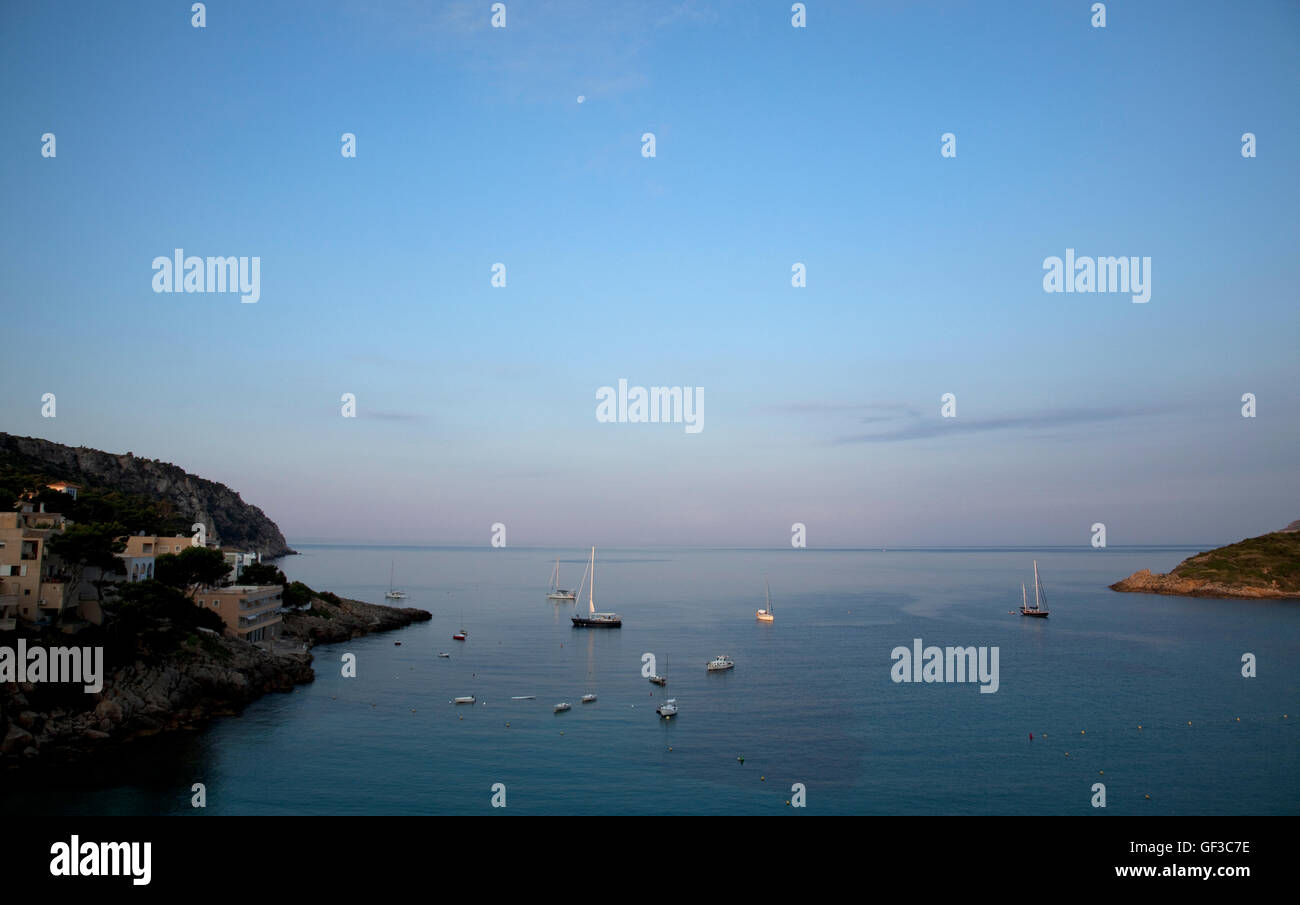 Boats anchored in the bay of Saint Elm, Mallorca, Spain at sunrise. - Stock Image