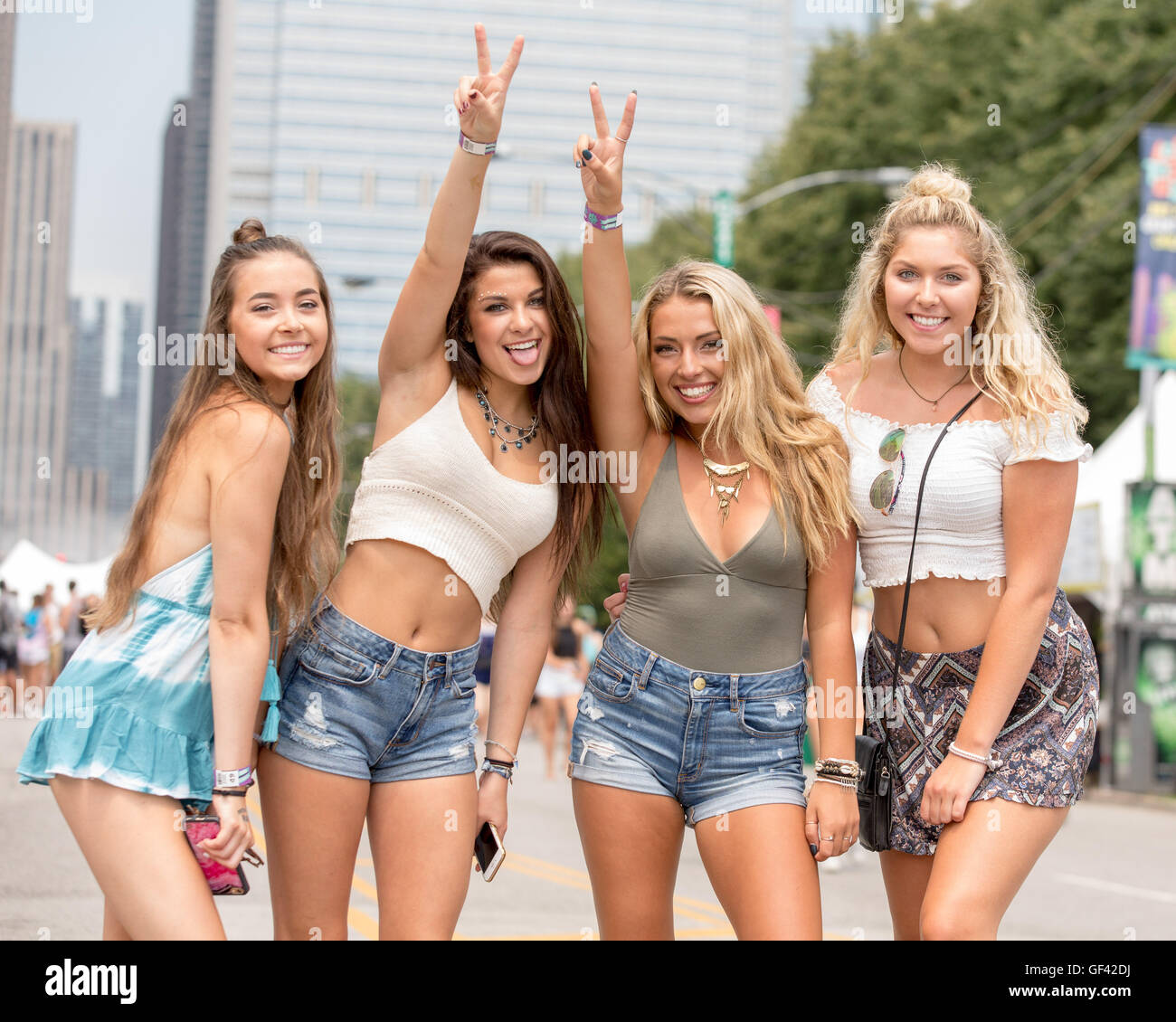 Chicago, Illinois, USA. 28th July, 2016. Female fans attend Lollapalooza Music Festival at Grant Park in Chicago, - Stock Image