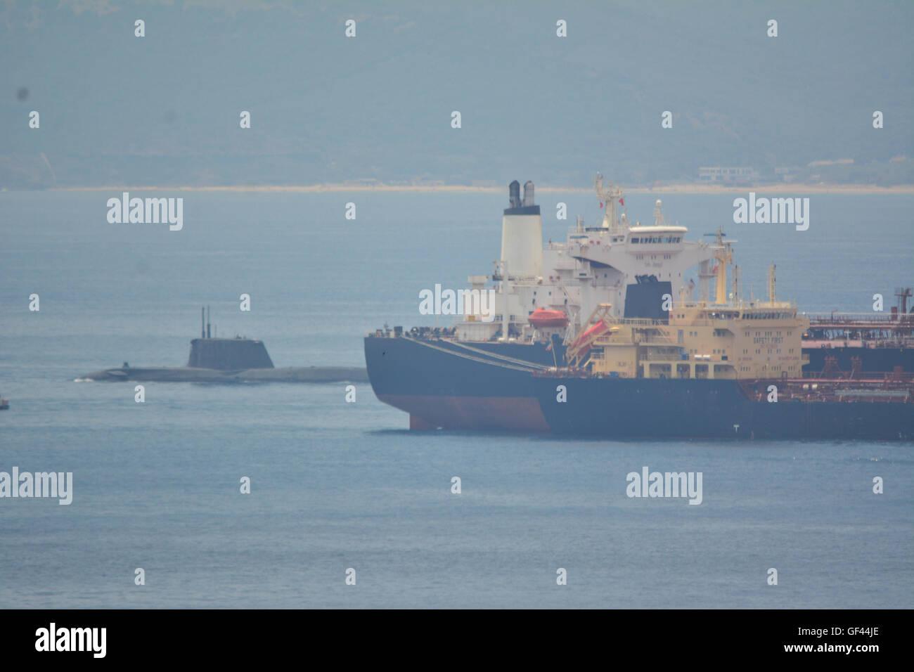 Gibraltar. 29th July, 2016. The stricken nuclear submarine HMS Ambush departs the British Naval Base of Gibraltar - Stock Image