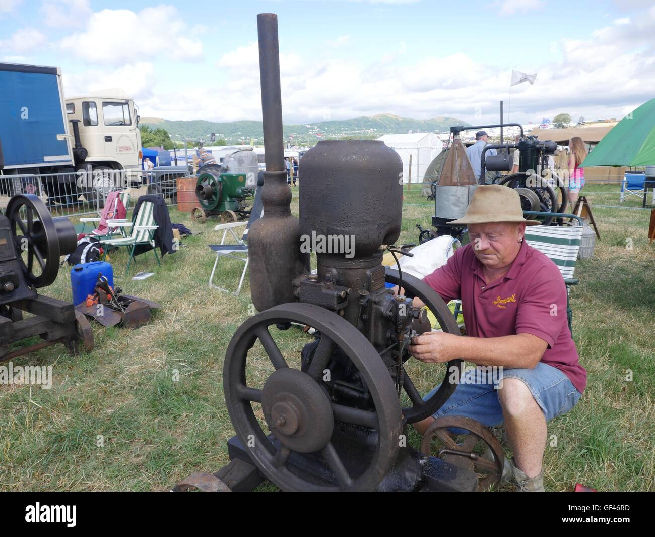 near Malvern, UK. 29th July, 2016. Bob Townsend of Tadley, Hampshire attending to one of his petrol/parafin powered - Stock Image