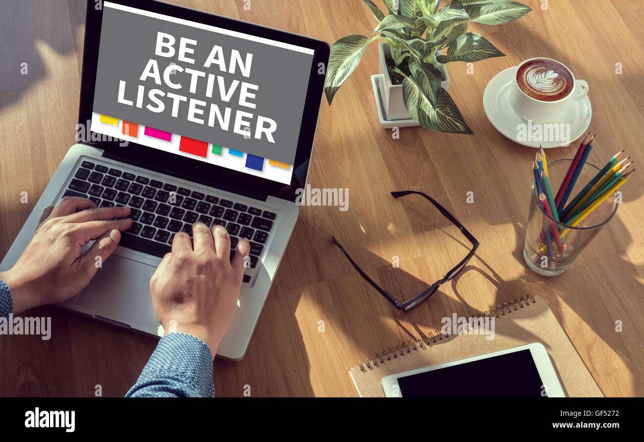 BE AN ACTIVE LISTENER man hand on table Business, coffee, Split tone - Stock Image