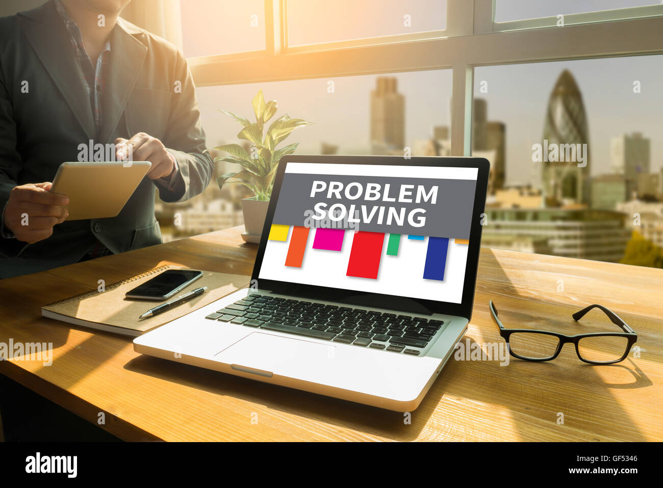 PROBLEM SOLVING Thoughtful male person looking to the digital tablet screen, laptop screen,Silhouette and filter - Stock Image