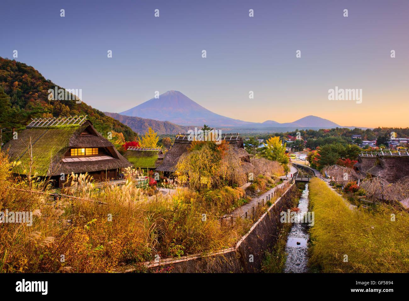 Mt. Fuji, Japan with historic village Iyashi no Sato during autumn. - Stock Image