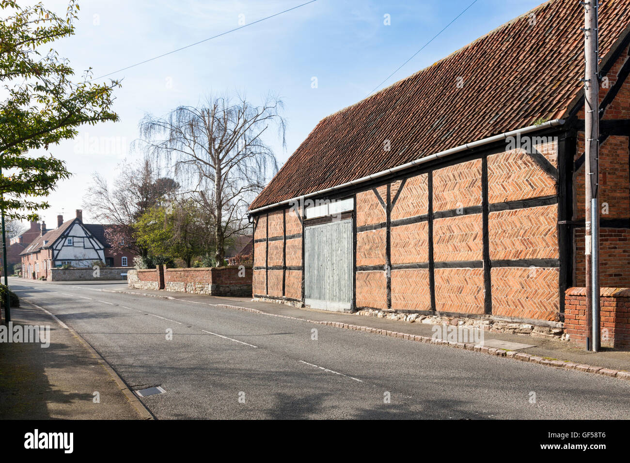 Old timber framed building with herringbone brickwork in the village of Hoton, Leicestershire, England, UK - Stock Image