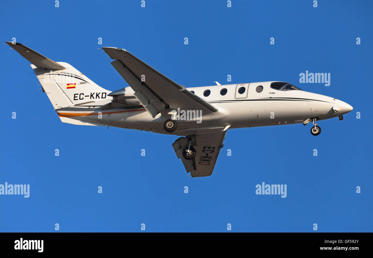Raytheon Hawker 400XP approaching to El Prat Airport in Barcelona, Spain. - Stock Image