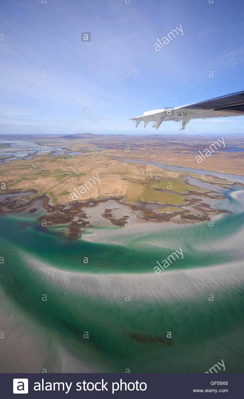 The view from the inter-island airplane as it flies by South Uist, Outer Hebrides, Scotland. - Stock Image