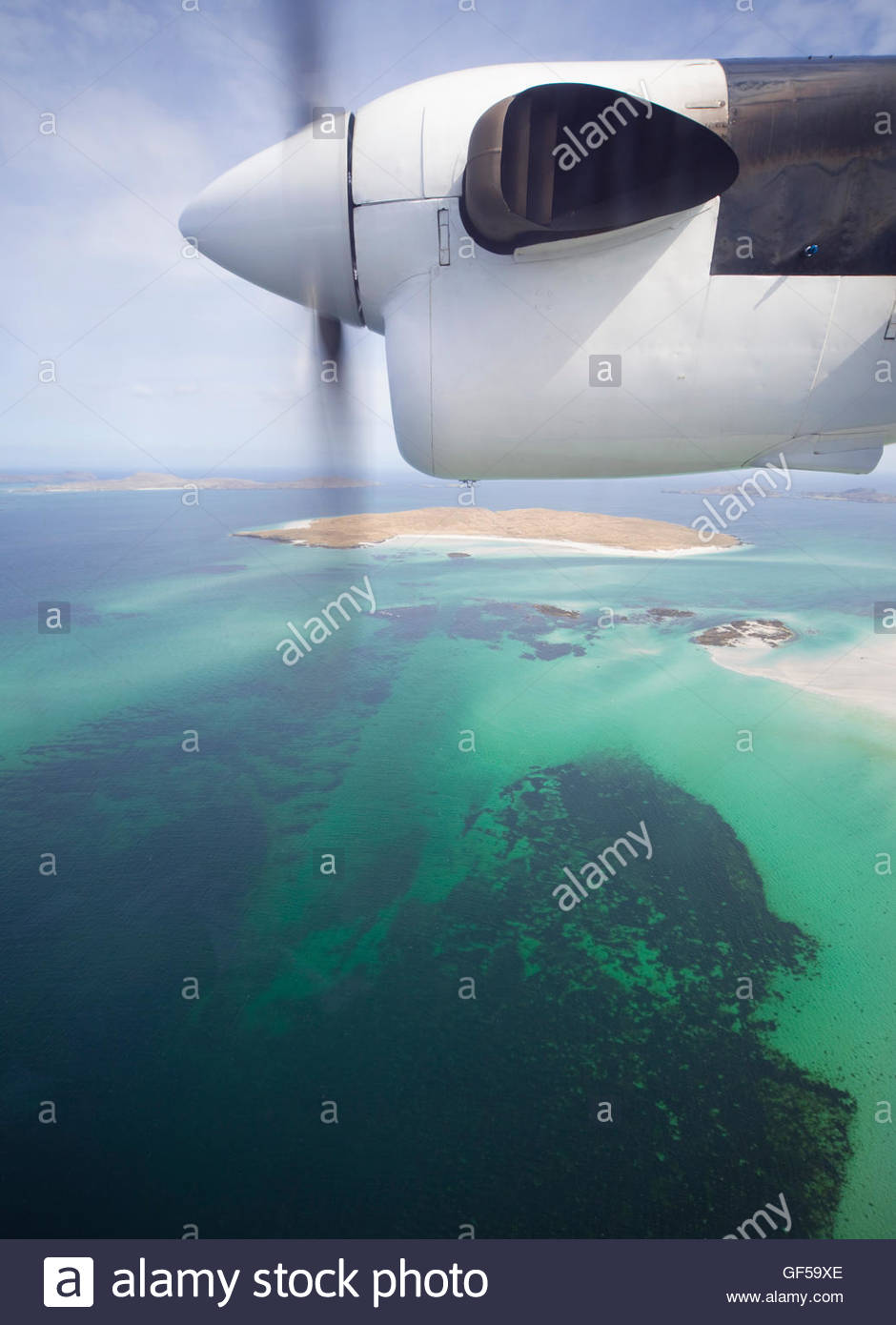 The view from the inter-island airplane to the Isle of Fuday of the coast of Barra, Outer Hebrides, Scotland. - Stock Image