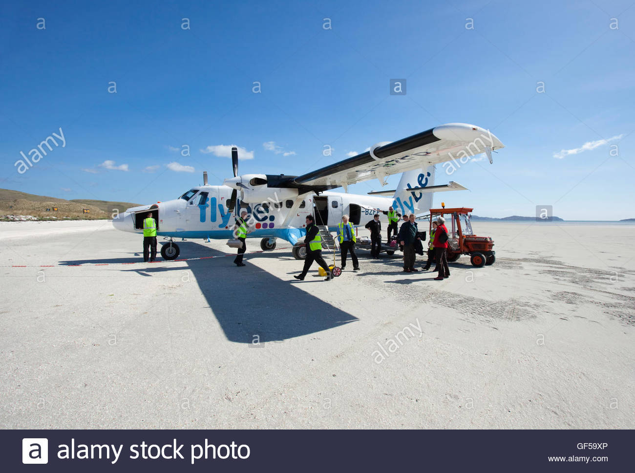 Ground staff prepare an aeroplane for take off on Traigh Mhor Beach - the runway for the Isle of Barra Airport, - Stock Image