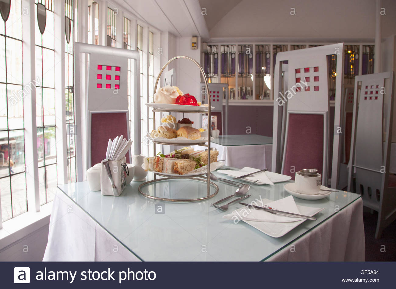 Afternoon tea in the Willow Tearoom designed by celebrated Glasgow architect, Charles Rennie Mackintosh, Glasgow - Stock Image