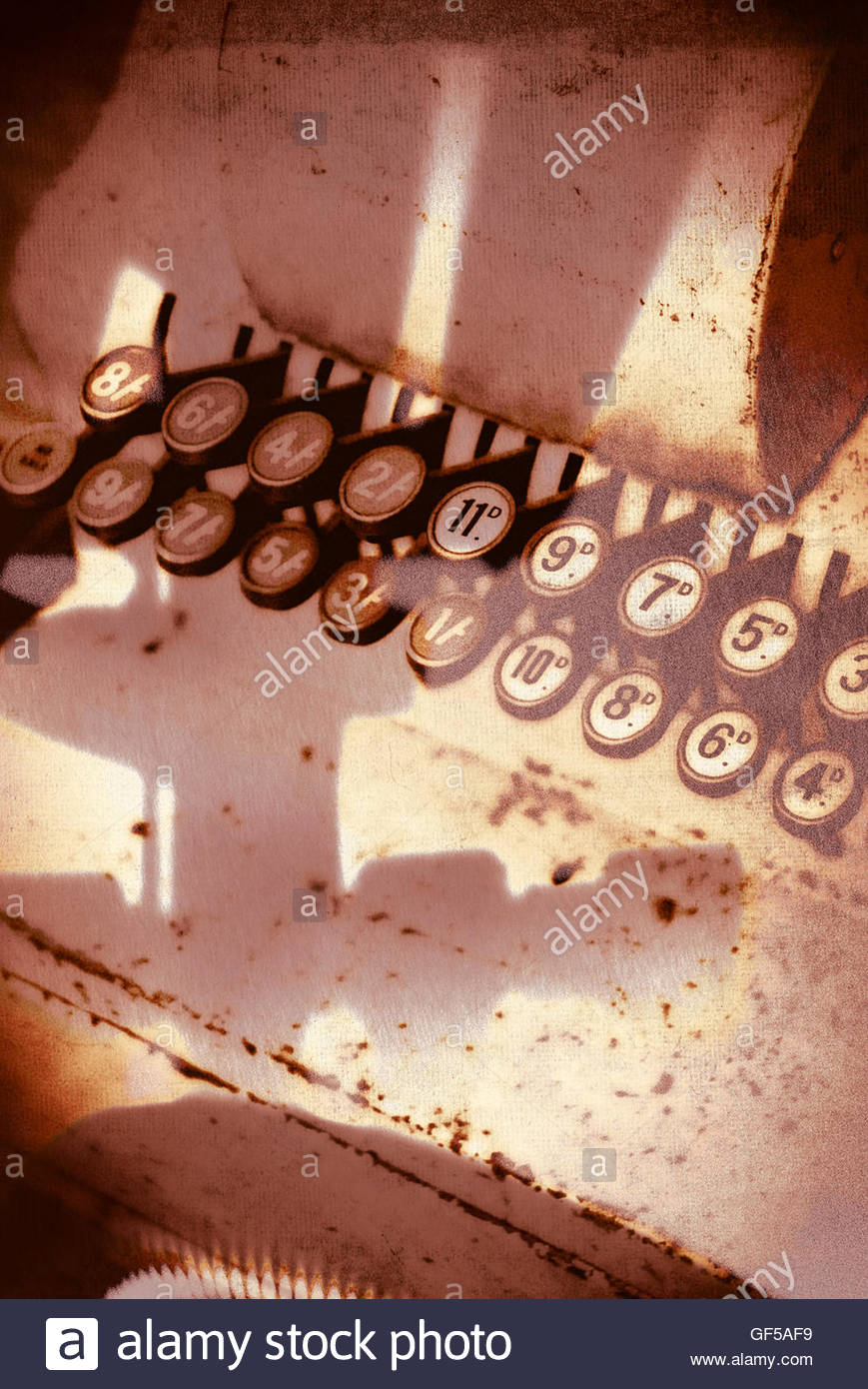 Vintage shop till keys moody image with strong shadows Stock Photo