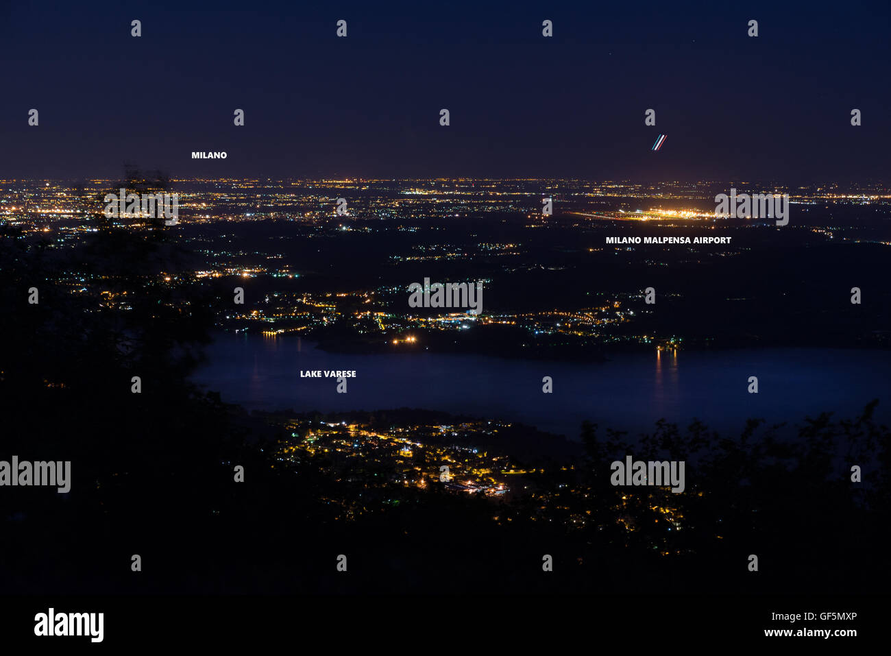 Night view of the airport of Milan Malpensa, Milan and lake Varese - Stock Image