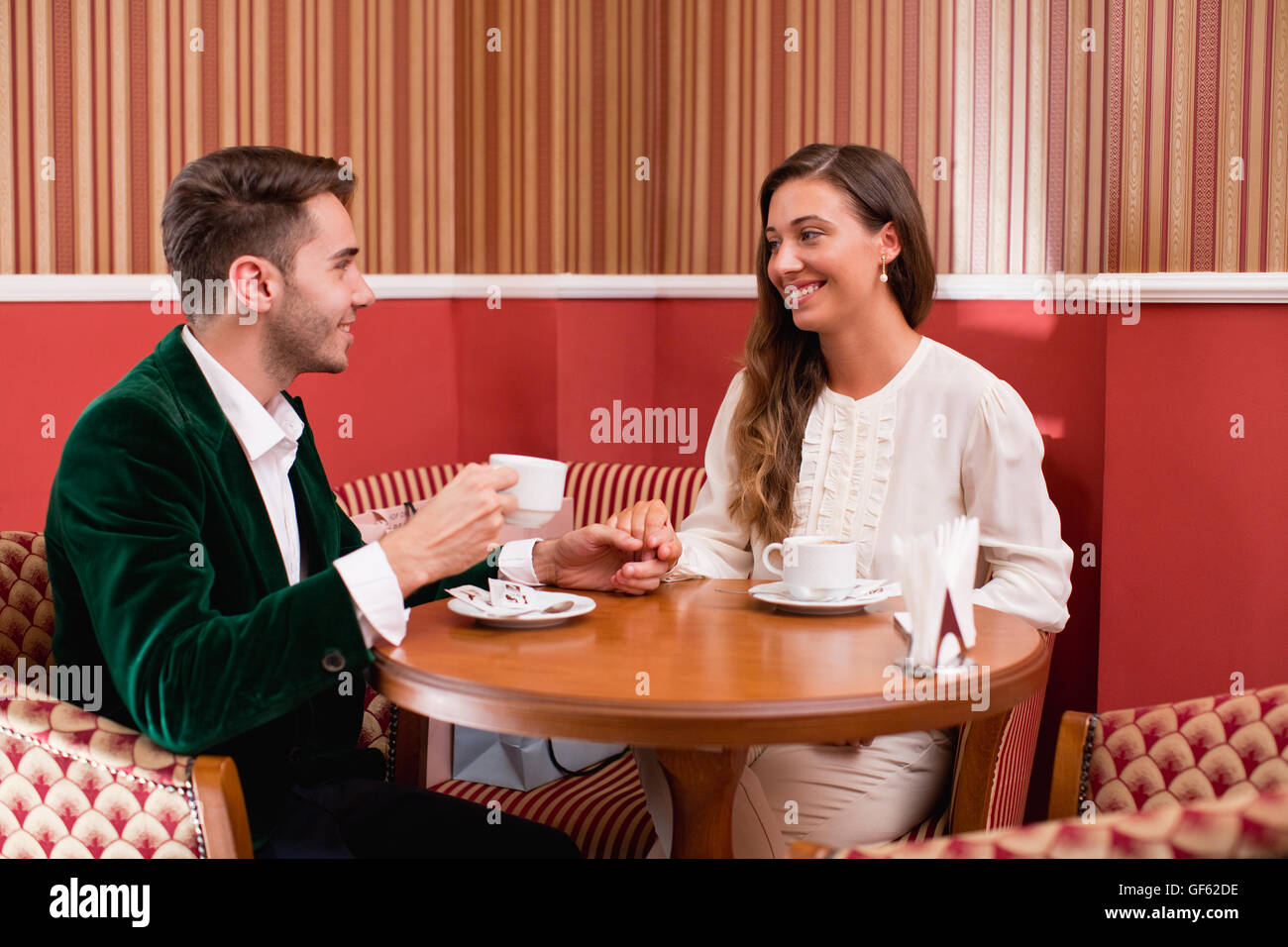 Young couple sitting in cafe. - Stock Image