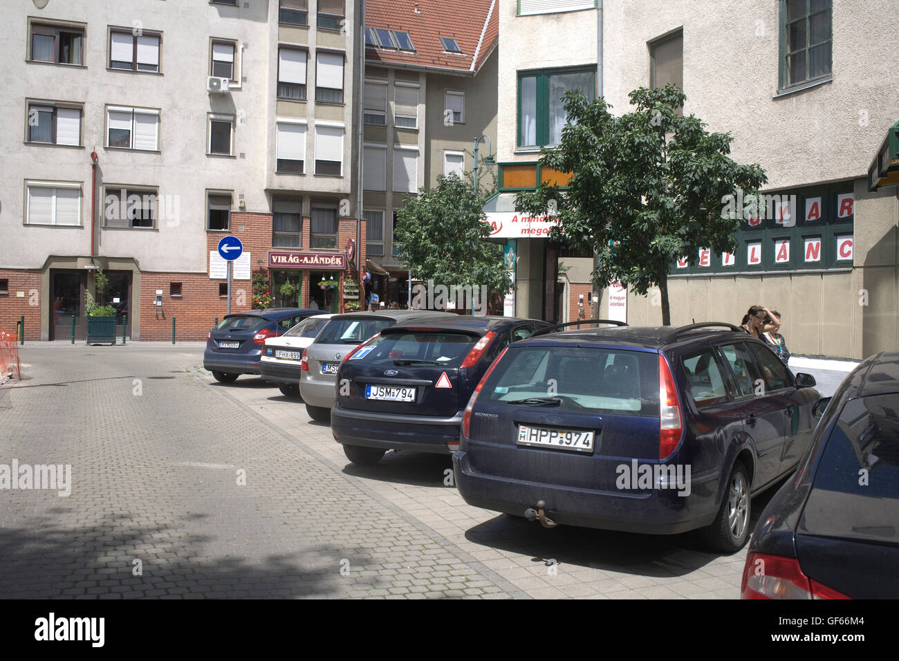 parked cars on a quiet street in district IX - Stock Image