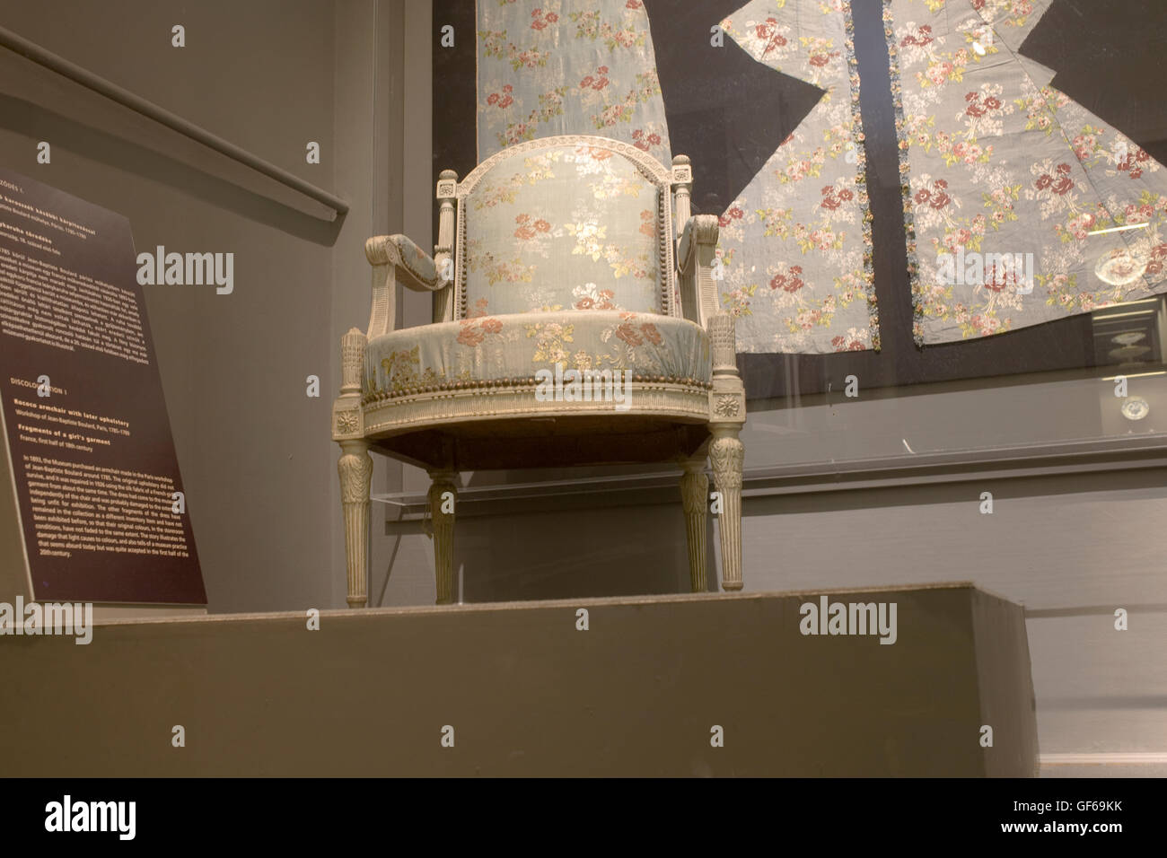 French armchair repaired with girl's dress in Musuem of Applied Arts - Stock Image