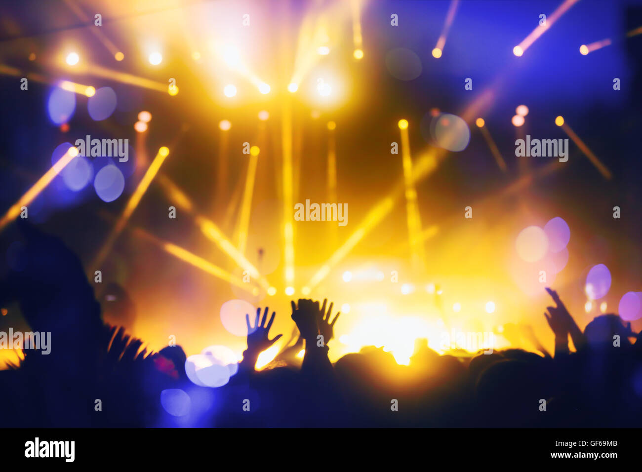 Crowd enjoying festival and live music concerts - Stock Image
