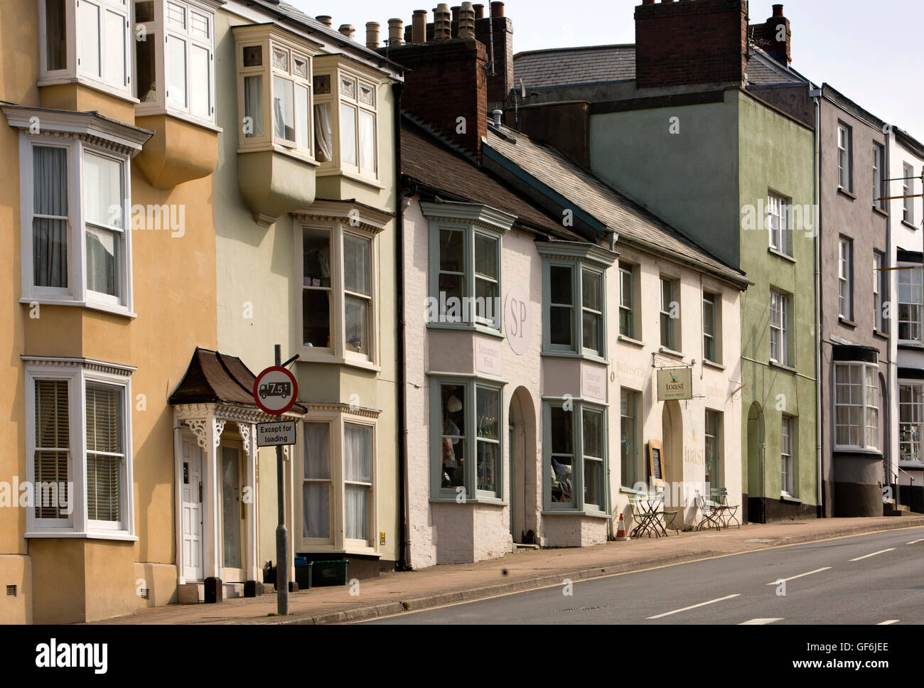 UK, England, Devon, Honiton, High Street, houses, shop and cafe outside town centre Stock Photo
