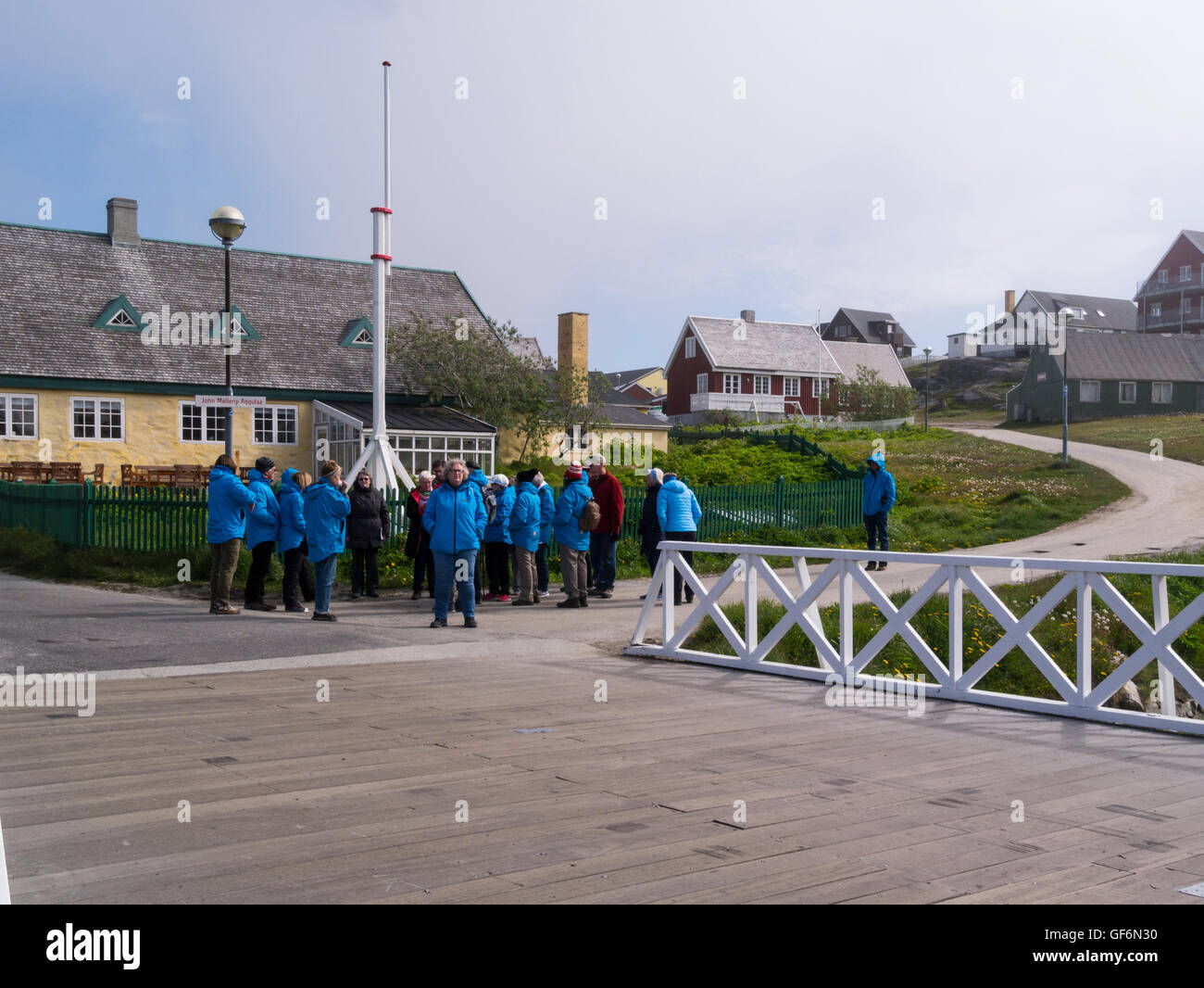 Group tourists on walking tour of Nuuk capital of Greenland countrys largest cultural centre in  Sermersooq municipality Stock Photo