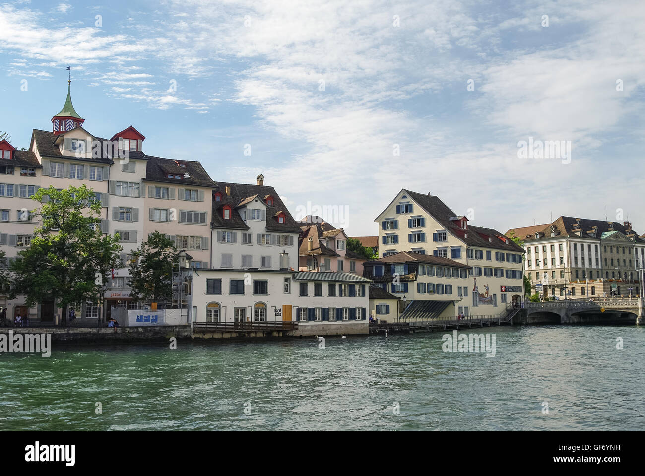 Zurich, Switzerland- august 22, 2010: Traditional houses on embankment Limmat river in historic Zurich city center - Stock Image
