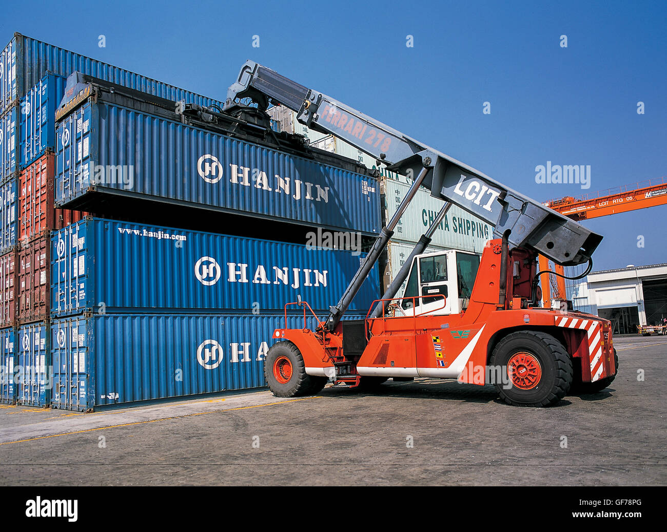 Storage and moving containers from truck in Port Stock Photo