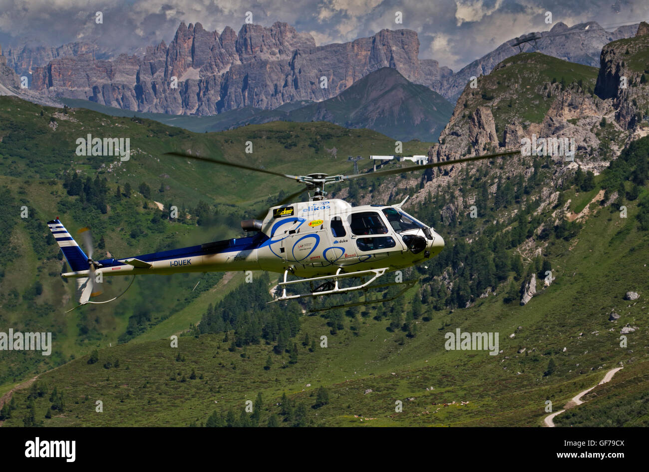 Helicopter in flight over the Pordoi Pass, Dolomites, Italy - Stock Image