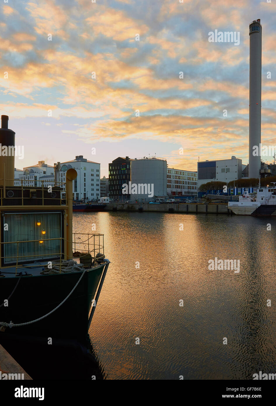 Cosy lights on boat moored at Hammarby Sjostad an eco neighbourhood, Stockholm, Sweden, Scandinavia Stock Photo