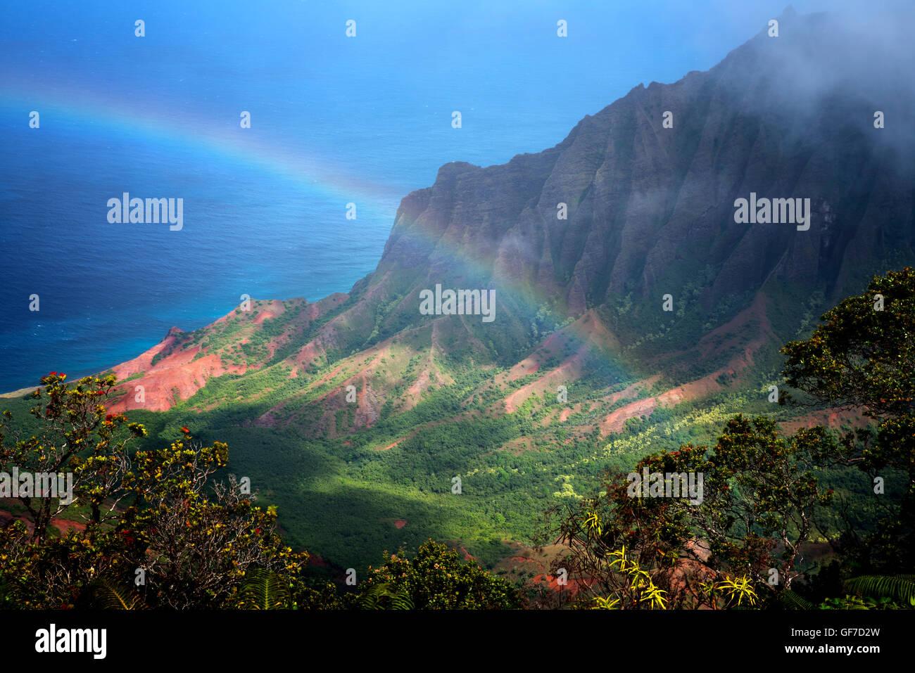 Rainbow as seen from Kalalau Lookout. Waimea Canyon. Kauai, Hawaii - Stock Image