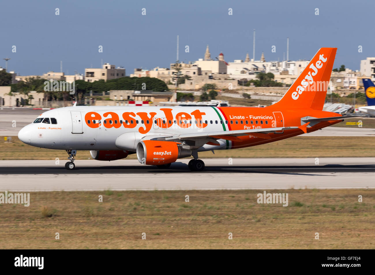 EasyJet Airline Airbus A319-111 carrying the special livery 'Linate - Fiumicino Per Tutti' takes off from - Stock Image