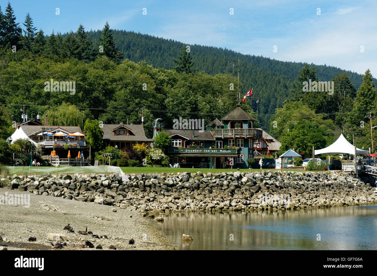 British Columbia Steamship Company Marina and other buildings at Snug Cove,  Bowen island, BC, Canada - Stock Image