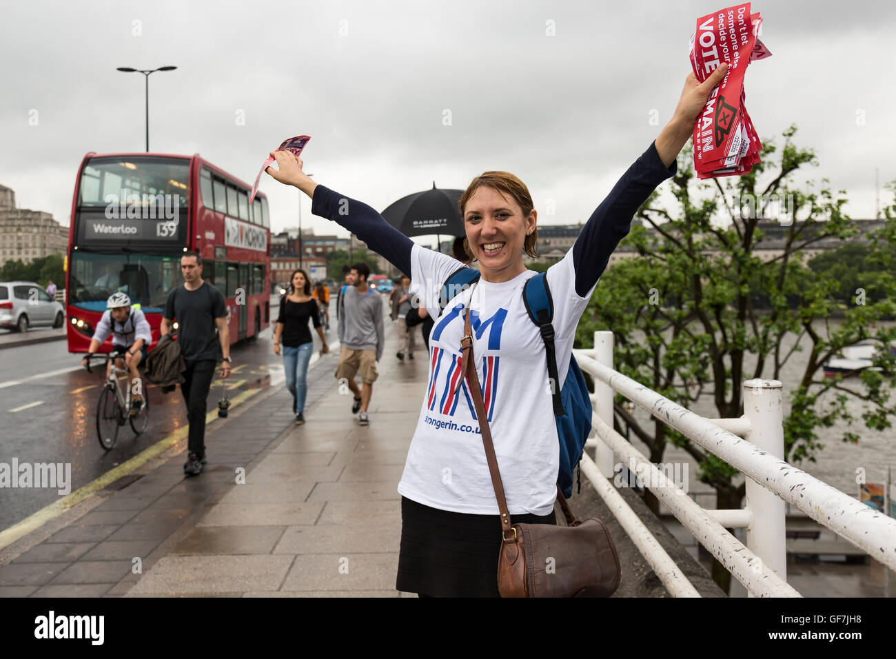 London, England - June 2016. A woman handing out Vote- Remain brochures to pedestrians - Stock Image