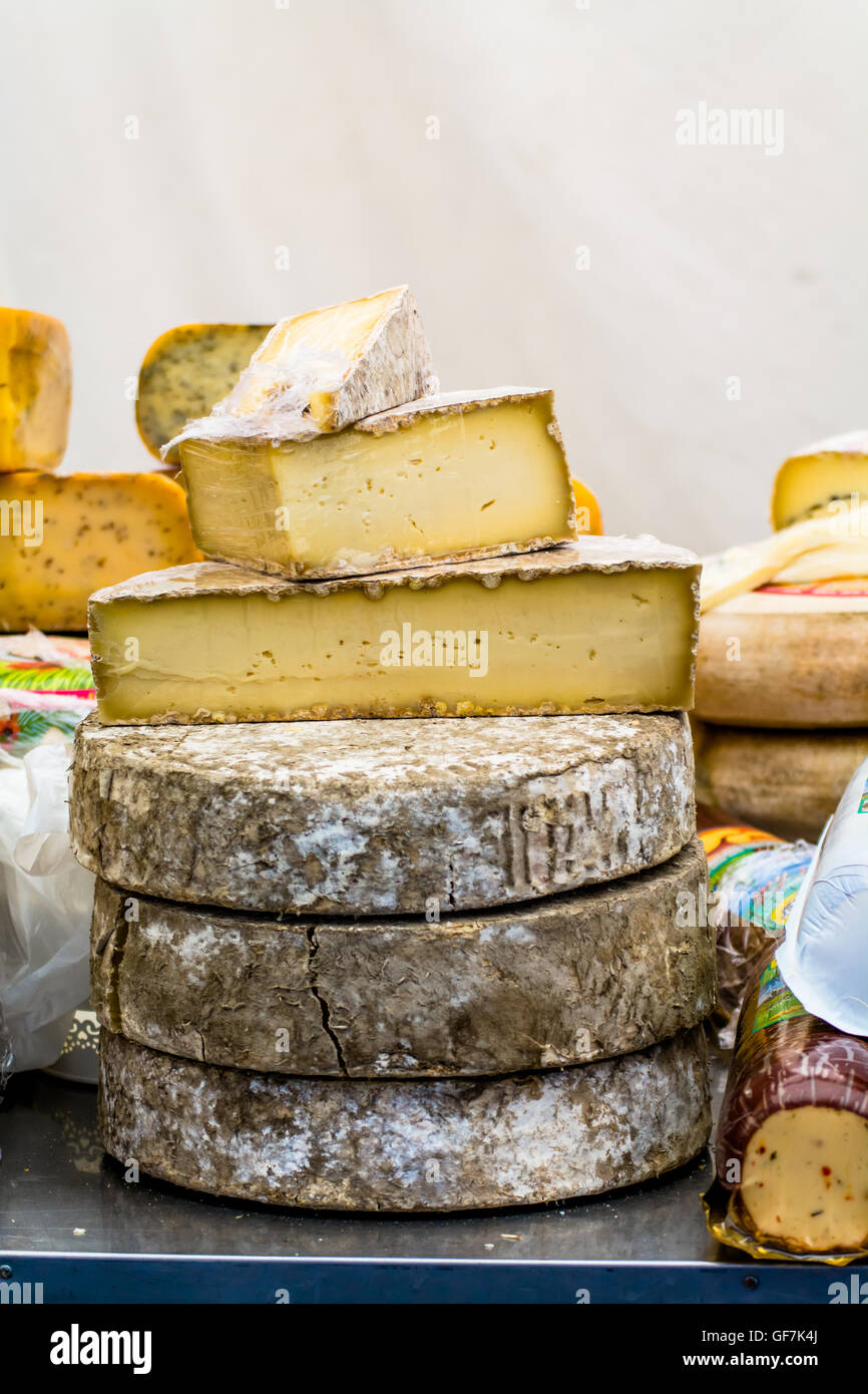 Close View Of Different Cheese On Street Market`Table Display Stock Photo