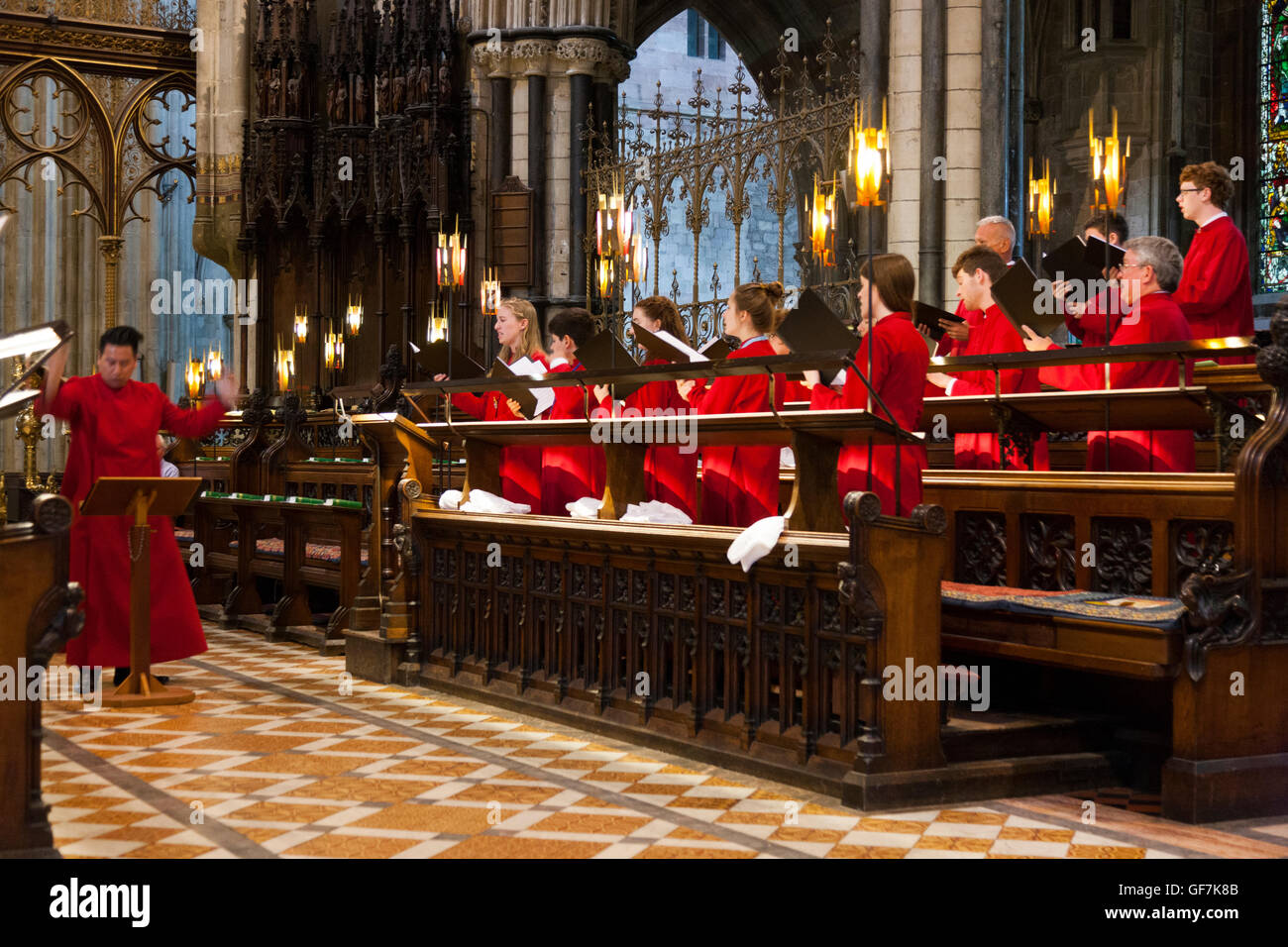 Choirmaster conductor of choir from USA singing / choristers sing / chorister sings / choirs pracising at Worcester - Stock Image