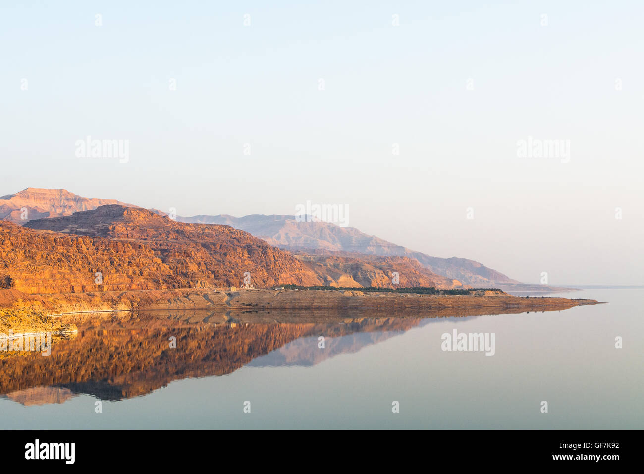Scenic View Of Calm Dead Sea Reflections Against Clear Sky - Stock Image