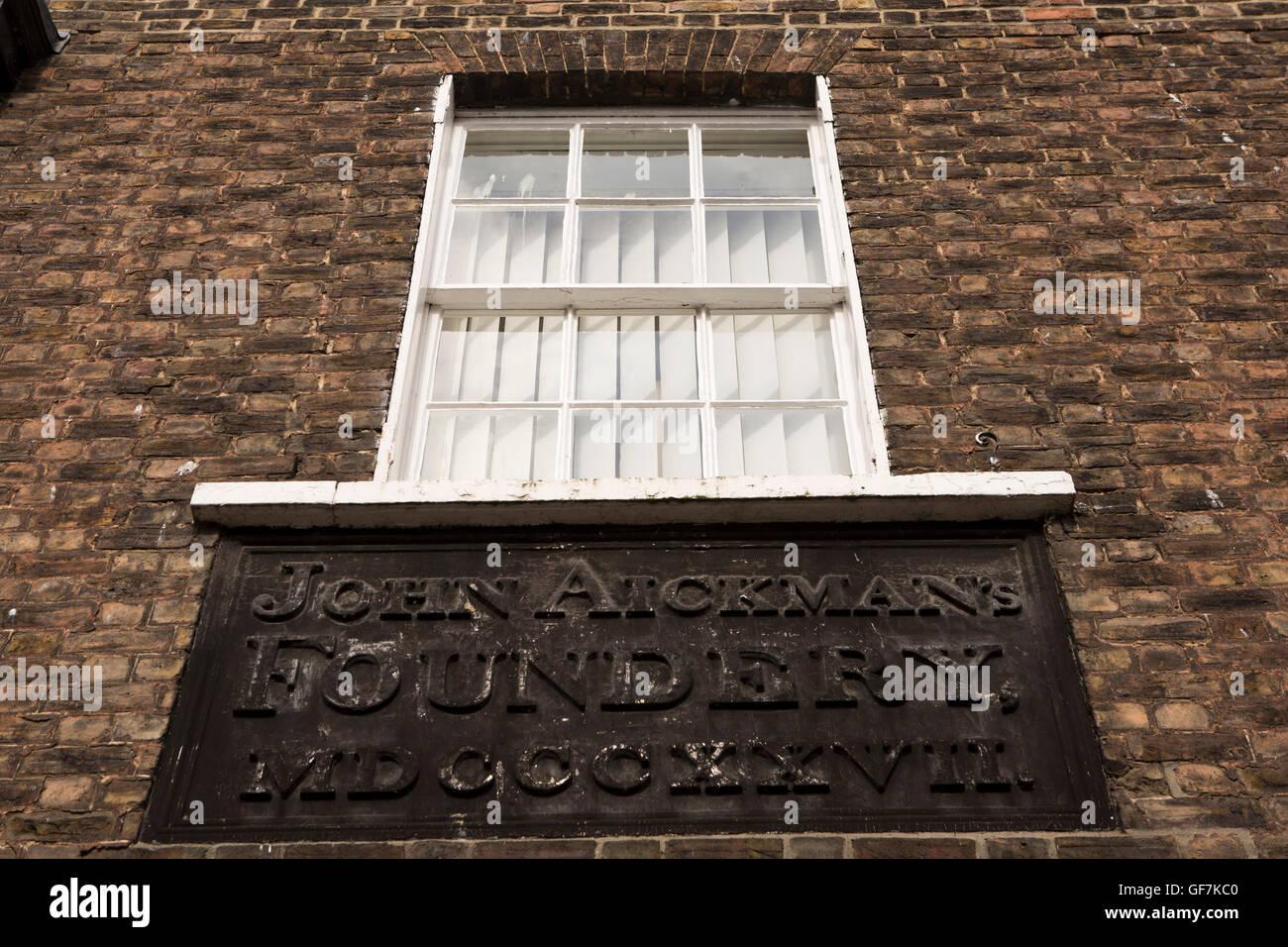 UK, England, Norfolk, King's Lynn, King Street, John Aickman's Foundry (Foundery) 1827 cast iron sign, Linnock Yard Stock Photo