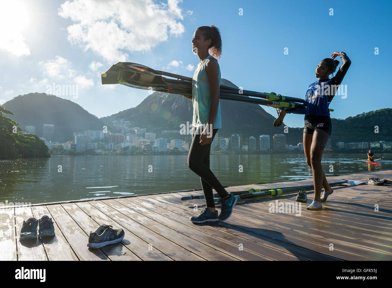 RIO DE JANEIRO - MARCH 22, 2016: After training, two female Brazilian rowers carry their boat back to the clubhouse - Stock Image