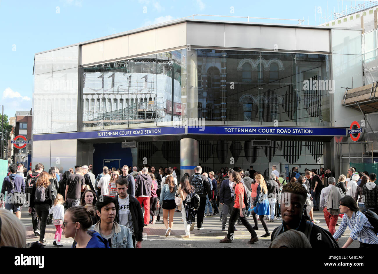 Commuters outside exterior Tottenham Court Station in Oxford Street in summer London UK  KATHY DEWITT - Stock Image