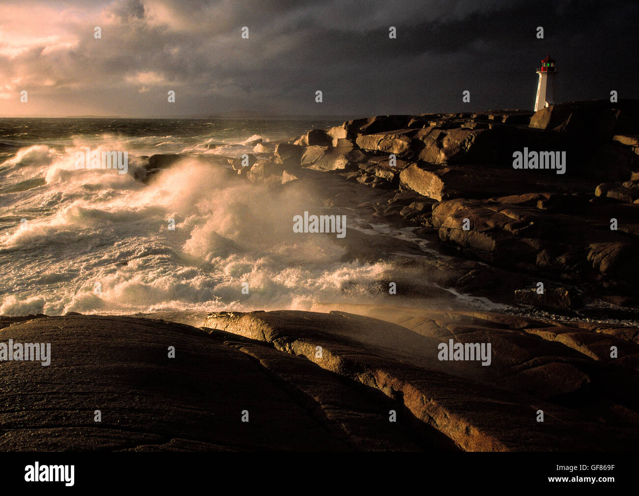 Peggy's Peggy Peggys Peggies Point Cove Lighthouse during a raging storm, Nova Scotia, Canada Stock Photo