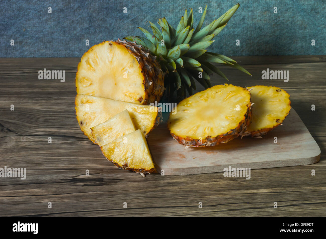 pineapple on the wood texture background - Stock Image