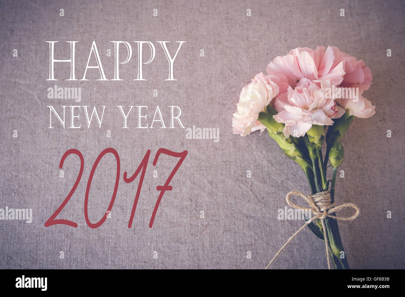 happy new year 2017 with pink carnation flowers bouquet toning background