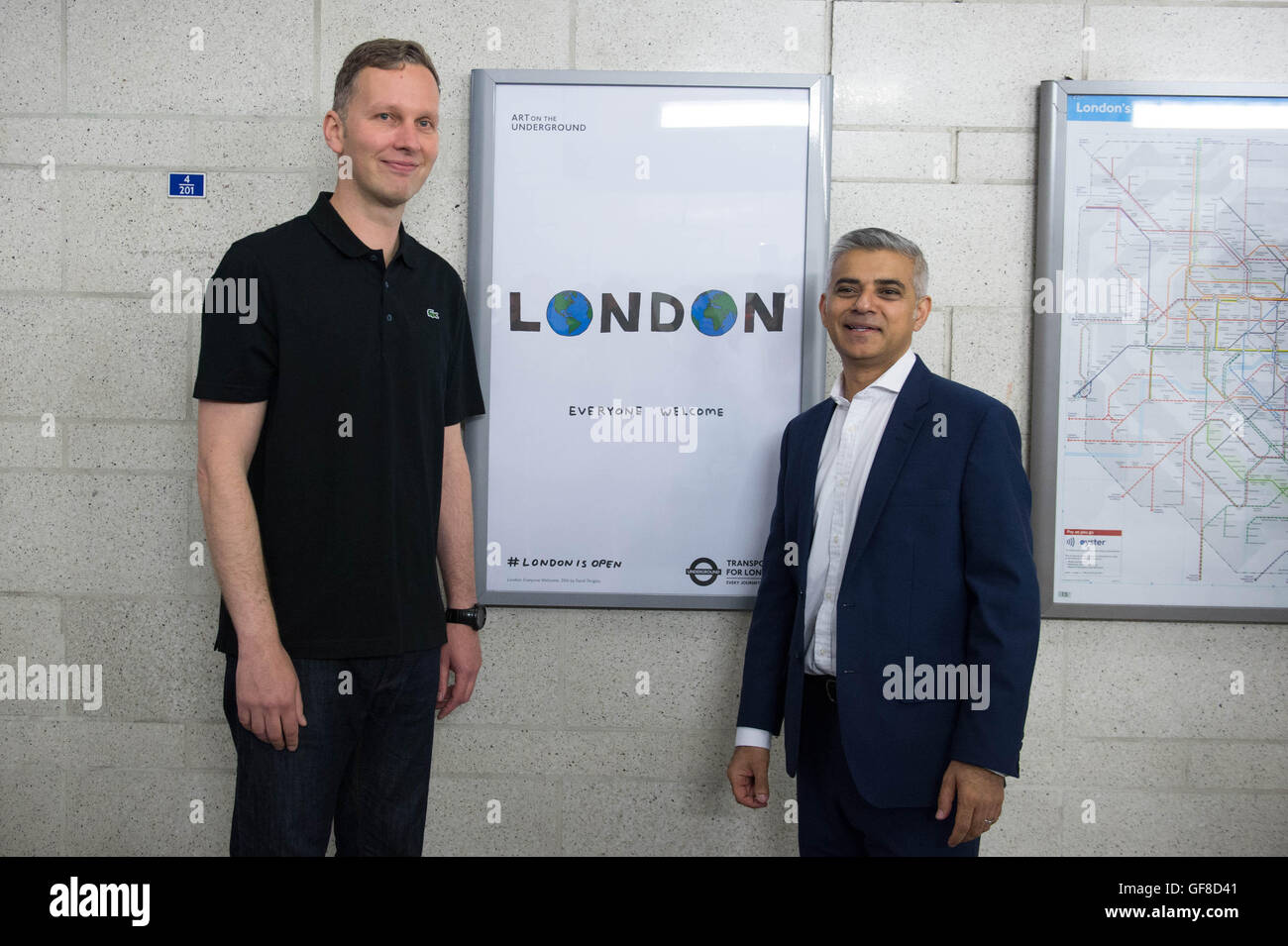 London Mayor Sadiq Khan unveils a new poster by artist David Shrigley (left) at Southwark Underground Station which - Stock Image