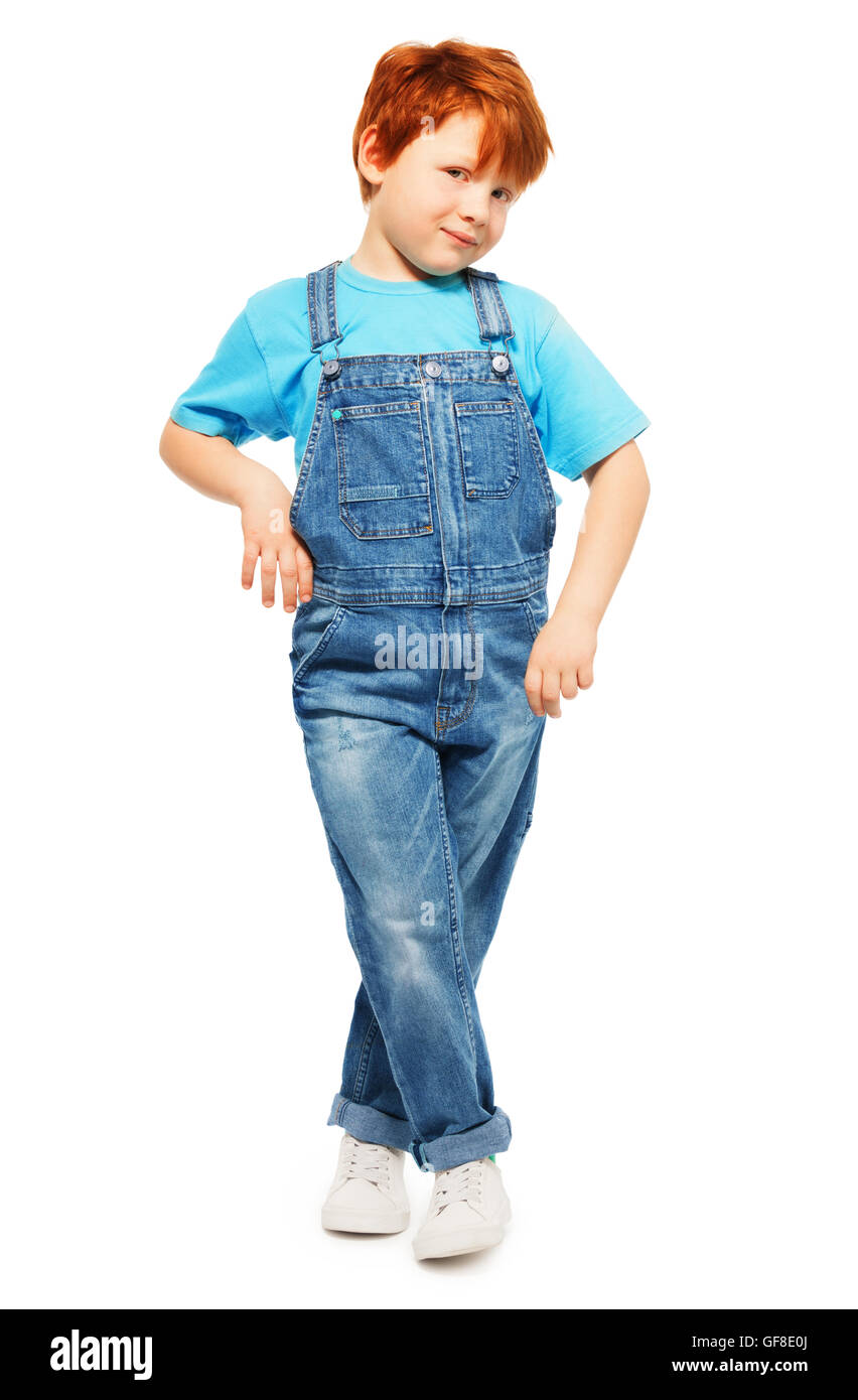Cute redheaded boy in overall and blue t-shirt - Stock Image