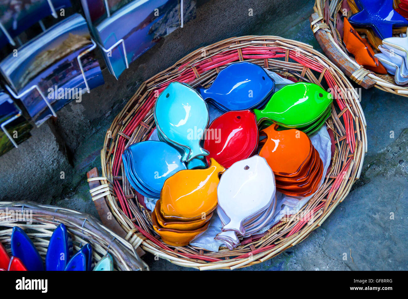 Traditional handmade ceramics products in Cinque Terre region Italy. Colorful plates in fish form. & Traditional handmade ceramics products in Cinque Terre region Italy ...